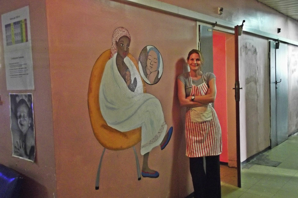 Alice with a kangaroo care mural in Addis Ababa hospital